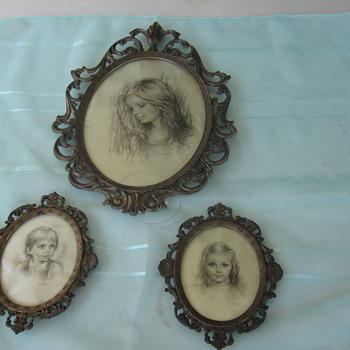 Framed silk portraits