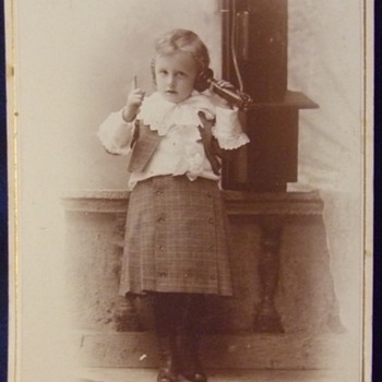 Cabinet card of toddler on wall mounted telephone - Photographs