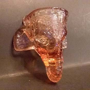 Pink glass elephant head wall pocket/match holder. - Tobacciana