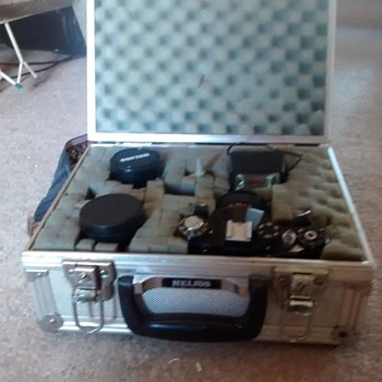 Zenit TTL SLR 35mm Film Camera with Helios case and additional lenses.