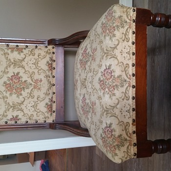 Antique chair with glass coasters on the front legs