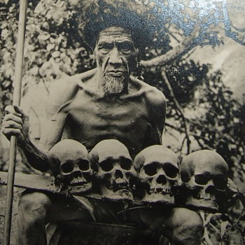 RPPC of Headhunter with his trophy skulls - Photographs