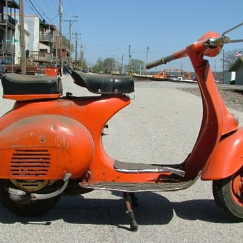 Orange Vespa - Motorcycles