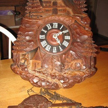 Heavily Carved Cuckoo Clock