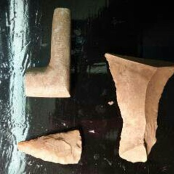 Indian artifact cache(arrowhead,stone pipe,scraper?)