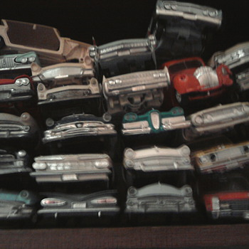 What do you do with broken promo and model cars.... Start a junk yard!
