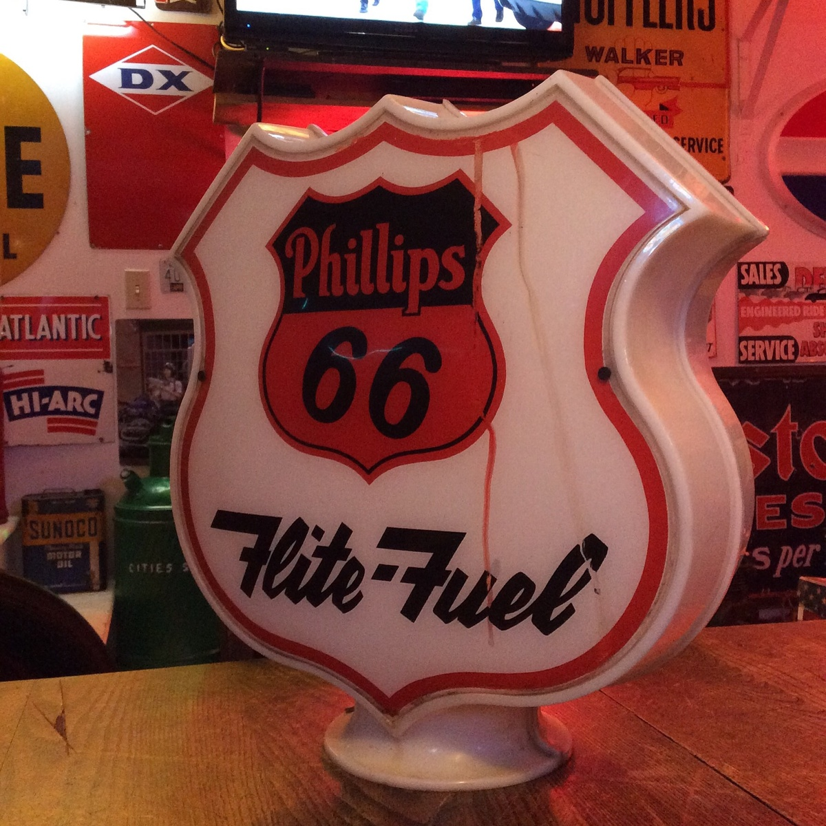 Two Phillips 66 gas globes and a Phillips Unique gas globe