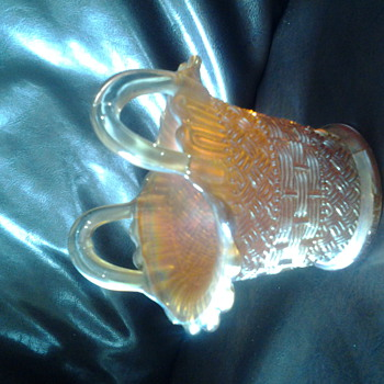 carnival glass basket in marigold colour
