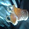 carnival glass basket in marigold colour