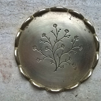 A Single Brass Coaster.  Any Clue About The Name?