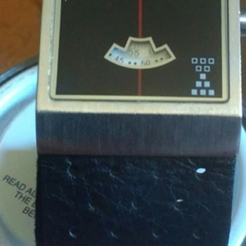 Watch with square face and unusual dials, not a smart watch or fitness gadget from unknown company.