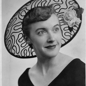 Looking for age of a hat in this photo. Black lace with rose. Very stylish. - Hats