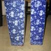 Two blue-flowered vases