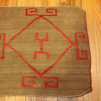 Small textile rug saddle blanket with red design