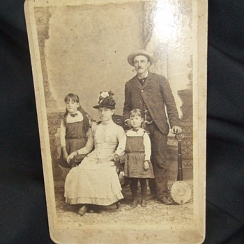 Cabinet card of Man with Family and his Banjo
