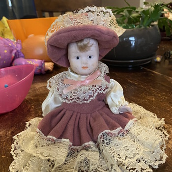 Porcelain doll no markings but made in China Sticker on foot  - Dolls