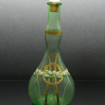 Bohemian enameled uranium glass barbers bottle
