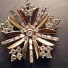 Vintage Trifari snowflake brooch