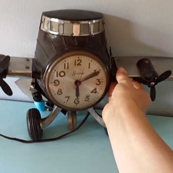 Prop plane Sessions clock - Clocks