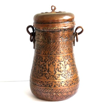 Antique Middle Eastern copper pot with earrings