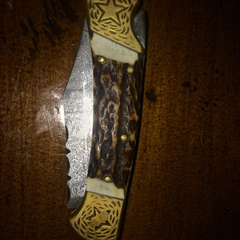 Damascus Steel Folding Knife with Antler & Brass