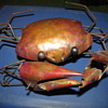 Hand-hammered copper mechanical crab (somewhat like a push toy) with wheels & snapping claws