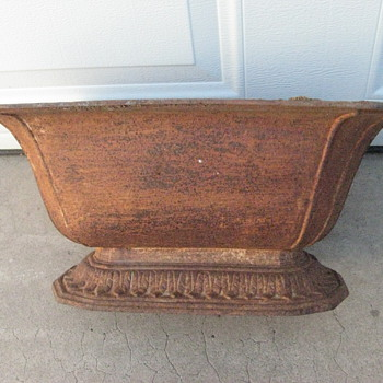 Victorian era pot or planter appears to be cast iron?