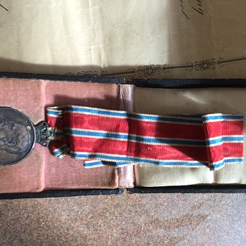 I found this medal with some papers  - Medals Pins and Badges