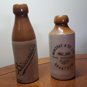 Two Stoneware Beer Bottles