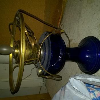 Need help identifying blue glass lamp
