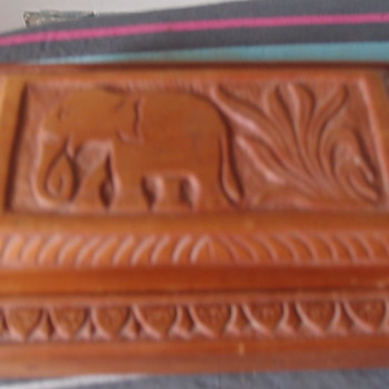 Elephant decorated twin secret compartment all wood, treen box, unknown wood with soft decorated material inside.