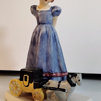 W. Goebel - Girl with Toy Horse and Carriage . - Figurines