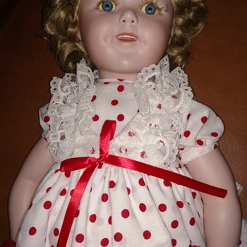 Help me find out about this SHIRLEY TEMPLE PORCELAIN DOLL