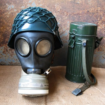West German gas mask and helmet with storage canister