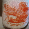 "DOUGLAS WYOMING MILK BOTTLE FEATURING ""NATURAL BRIDGE""........."