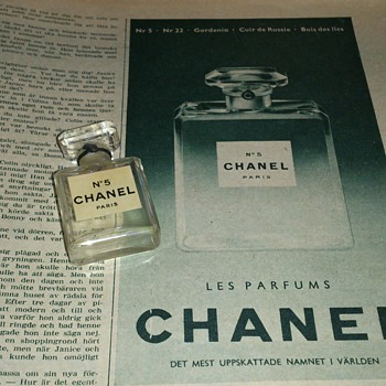An add for Chanel no 5 in a magazine from 1953 together with grannys old perfume bottle - Advertising