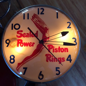 New marquee and sealed power clock - Advertising