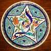 Plate tile?  Similar to SEANS, Do not know age of history, from thrift store also