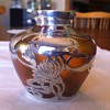 Art Nouveau Loetz-type vase with sterling silver overlay.