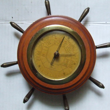 "Nice old ""Ships Wheel"" style barometer."
