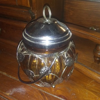 Amber glass biscuit jar with silver leaves and musical - Glassware