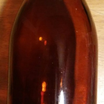 Brown tall jar  - Bottles