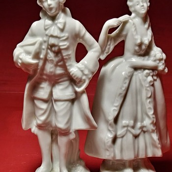 Bisque Porcelain Lady & Man with Green 5 point Crown & Capital N under it inscribed on Bottoms - Figurines