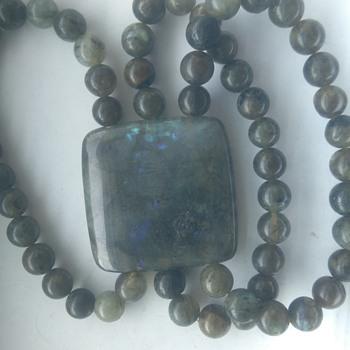 Large mineral stone bracelet with vibrant blue inside the stone labradorite