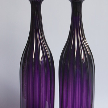 A pair of amethyst decanters