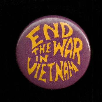 2 versions of End the War in Vietnam pinback buttons