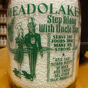 Meadowlake Milk Quart Bottle featuring Uncle Sam & a Lady Cook ..... - Bottles