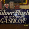 silver flash gasoline sign