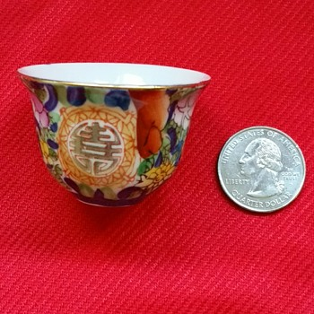 """Porcelain tea cups with gold rims and symbols. 1 1/2 """" tall - Asian"""