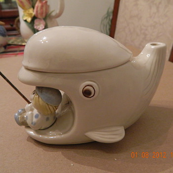 The fisherman fished. Do you know something about this teapot? - Pottery